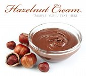 picture of hazelnut  - Hazelnut cream with hazelnut nuts on white - JPG