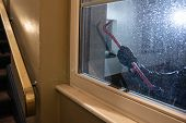 Burglar Trying To Open Window With Crowbar At Night poster