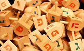 pic of dreidel  - close up of hanukkah dreidels on market stand - JPG
