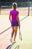 Close Up Shot Of Attractive Female Tennis Player In Uniform With Tennis Racket And Ball Walking On T poster