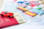 Going To Travel. Passport, Magnifier, Red Toy Car And Money On Map. Save Money On Travel, Planning F poster
