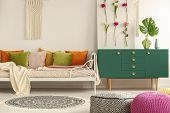 Handmade Flower Board On Green Wooden Cabinet With Leaf In Glass Vase Next To Comfortable Bed With O poster