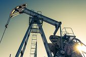Oil Pumpjack, Industrial Equipment. Rocking Machines For Power Generation. Extraction Of Oil. poster