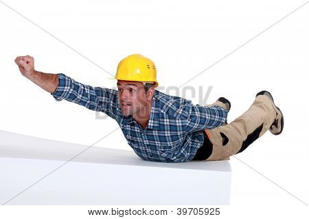 Manual worker in superman pose