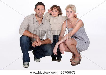 Foto de estúdio do pais e seu filho