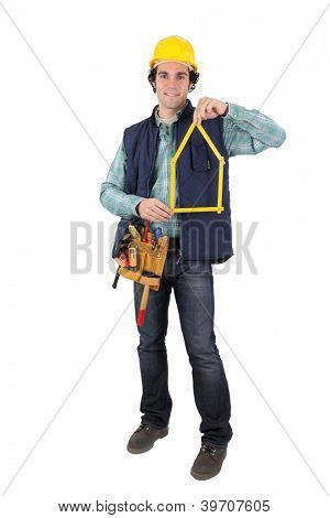Man holding tool in shape of house