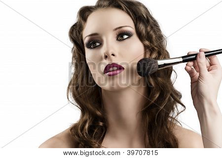 Girl Getting Made-up By Hands With Brushes, Looks At Right