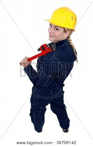 Tradeswoman holding a pipe wrench