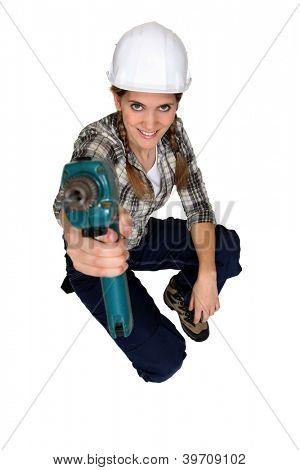 Tradeswoman using a power tool