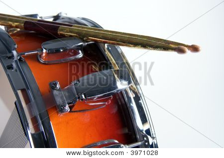 Red Fade Snare Drum And Sticks Isolated On White