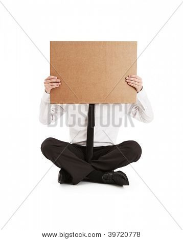 Man holding on his face cardboard