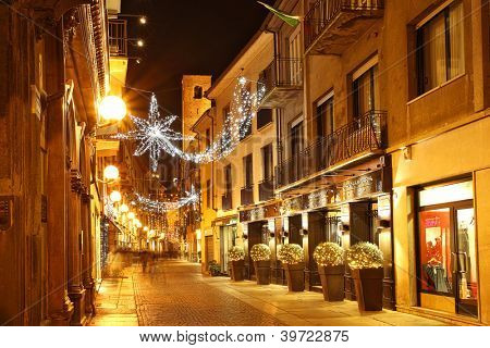 ALBA - DECEMBER 07: Popular touristic street in historic center of Alba with opened shops, bars and restaurants  decorated for Christmas and New Year on December 07, 2011 in Alba, Northern Italy.