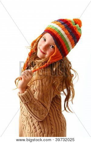 Coquettish Little Girl In Cozy Clothes Isolated On White Background
