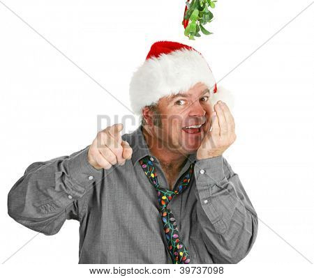 Pushy guy checks his breath under the mistletoe at the office Christmas party.  Isolated on white.