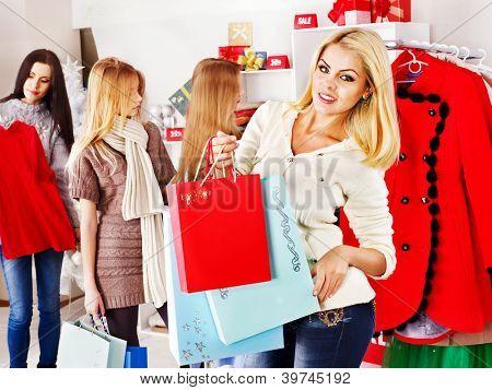 Shopping women at Christmas sales holding gift box.