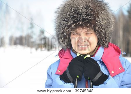 Close-up Portrait Of A Smiling Skier