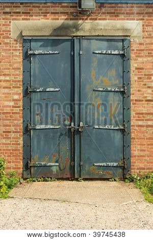 Old Rusty Padlocked Blue Metal Door