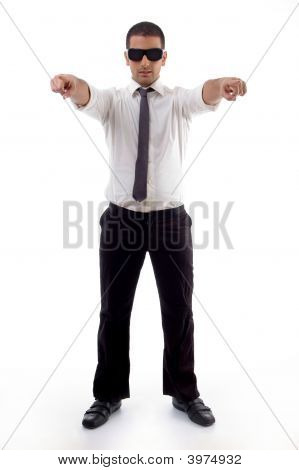 Standing Professional Man Pointing With Both Hands