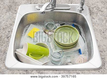 Dishes Soaking In The Kitchen Sink