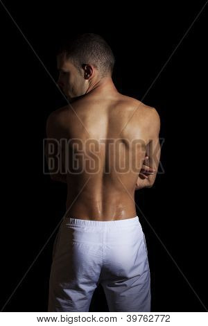 Athletic Guy On Black Background With Clipping Path