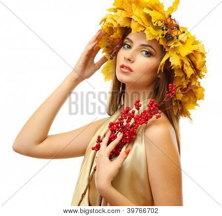 beautiful young woman with yellow autumn wreath and red berries, isolated on white