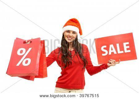 Menina feliz na tampa de Santa possui cartão e paperbags com símbolos de venda