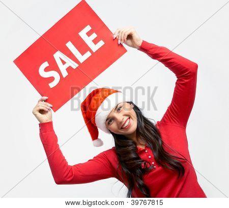 Menina feliz na tampa de Santa possui cartão com símbolo de venda