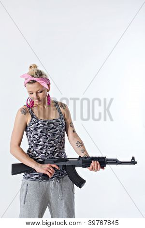 Young Woman With Automatic Rifle