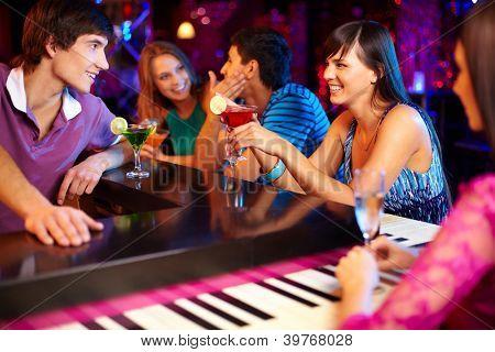 Portrait of joyful friends having party in the bar