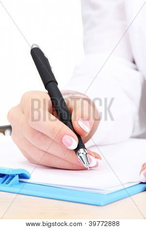 Closeup of businesswoman hand, writing on paper