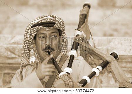 Bedouin play bagpipe