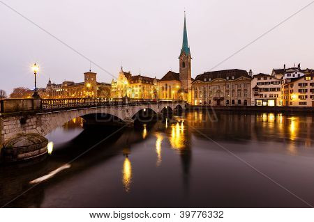 View Of Zurich And Old City Center Reflecting In The River Limmat At Morning, Switzerland