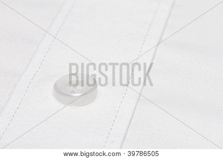 white button on formal white cotton shirt