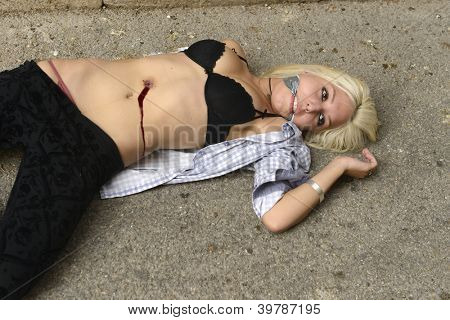 Crime scene: Dead body of a murdered girl or prostitute
