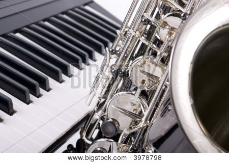 Saxophone And Piano Keys