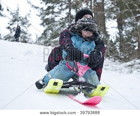 Downhill On A Snow Sledge