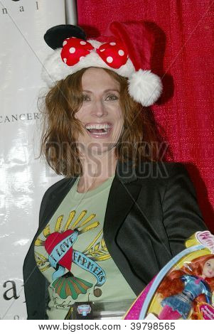 UNIVERSAL CITY - DEC. 4: Nancy La Scala arrives at publicist Mike Arnoldi's birthday celebration & Britticares Toy Drive for Children's Hospital on Dec. 4, 2012 in Universal City, CA.