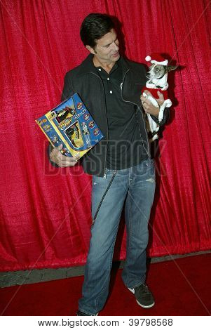 UNIVERSAL CITY - DEC. 4: Lorenzo Lamas & his dog Blueberry arrive at Mike Arnoldi's birthday celebration & Britticares Toy Drive for Children's Hospital on Dec. 4, 2012 in Universal City, CA.