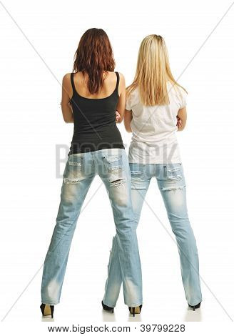 Rear View Of Two Sexy Women In Jeans