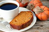 stock photo of cup coffee  - Slice of homemade pumpkin bread with a cup of coffee - JPG