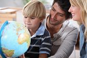 Little boy learning about the world with the help of his parents