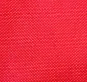 pic of nonwoven  - A Background Of Red Nonwoven Fabric Texture - JPG