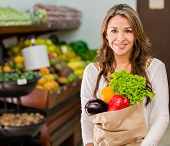 stock photo of local shop  - Woman grocery shopping at the local market - JPG