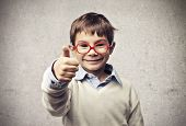 stock photo of cunning  - Child with glasses thumbs up - JPG