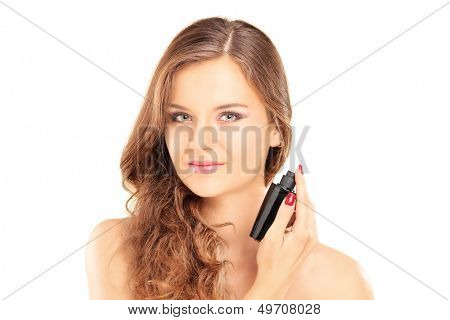 Portrait of a beautiful young female applying a perfume isolated on white background