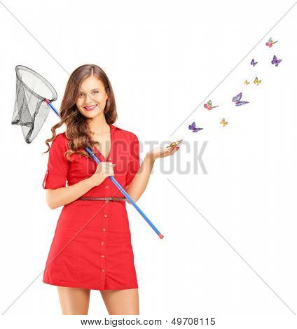 Smiling young female holding a butterfly net and butterflies around her isolated on white background, shot with a tilt and shift lens