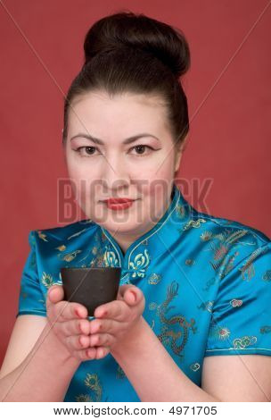 Japanese Girl With Teacup
