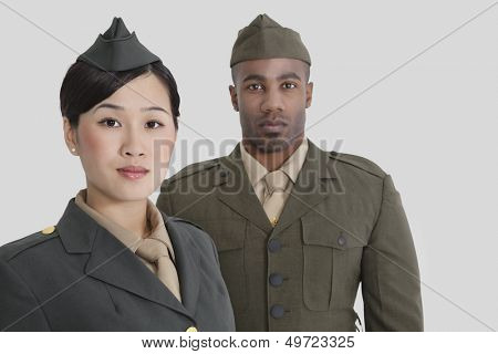 Portrait of young US military officers in uniform over gray background
