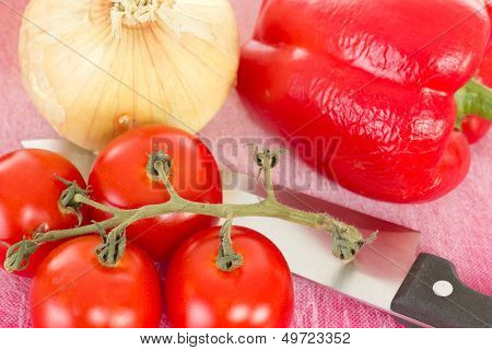 Preparing Lunch With Red Peppers Onions And Tomatoes