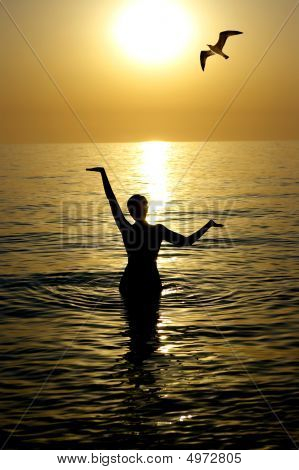 Young Beatiful Woman In A Sea